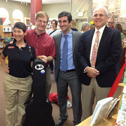 From L to R: Phoenix Books co-owner Renee Reiner, Nato, Burlington Mayor Miro Weinberger, Phoenix Books co-owner Mike DeSanto