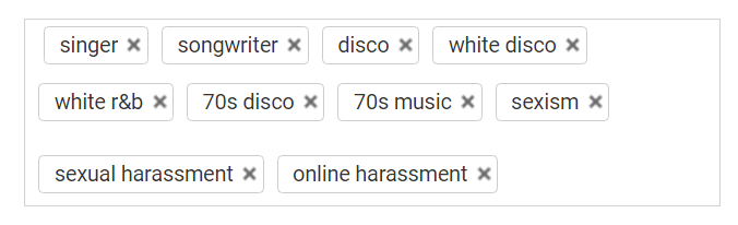 Screenshot of YouTube video's tags, including keywords such as 'disco', '70's music', and 'sexual harassment'